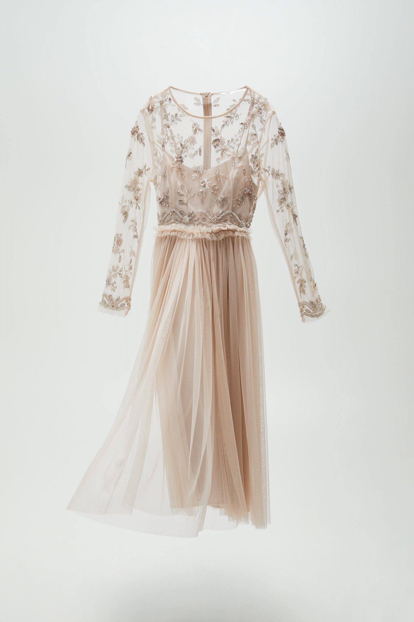 Light pink full-length dress with tulle skirt and beaded top with full-length sleeves
